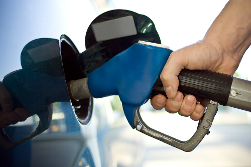 Driver filling up their gas tank
