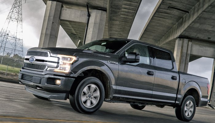 A 2018 Ford F-150 parked under a bridge