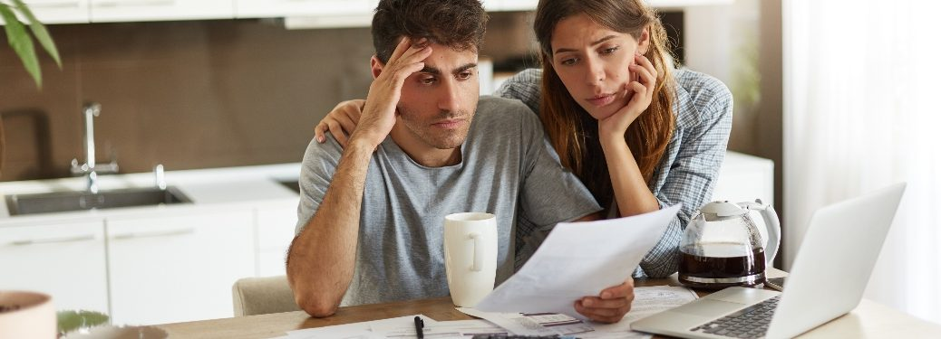 Couple looking stressed about financial situation
