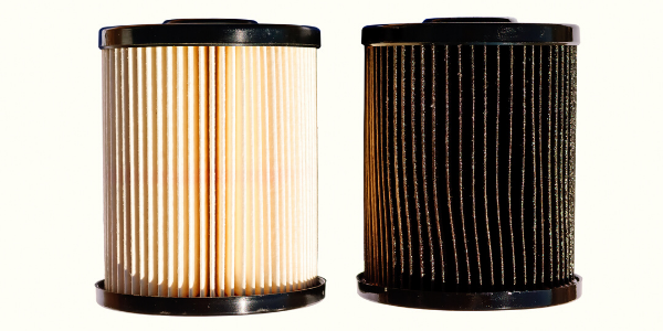 New and clean diesel fuel filter vs old and dirty filter