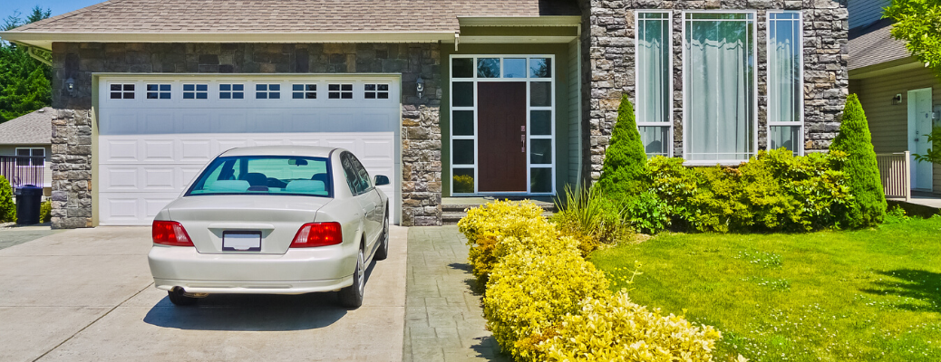 Car parked in house driveway