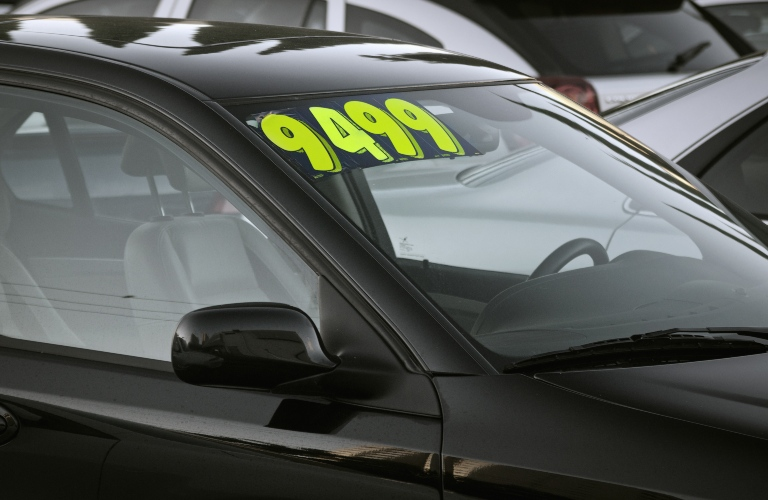 Car for sale with sticker in the windshield