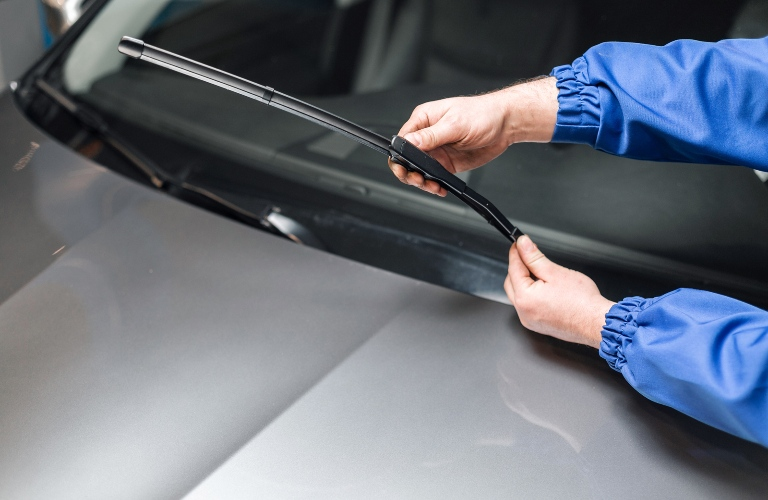 Person working on the windshield wipers