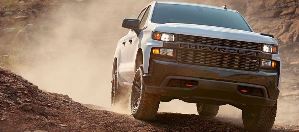 2020 Chevrolet Silverado 1500 going over a dirt hill