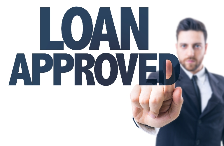 Man pointing at the words loan approved
