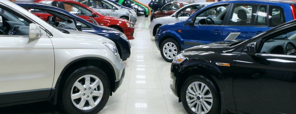 A stock photo of cars lined up in a showroom.