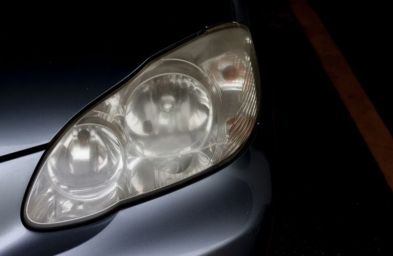 cloudy headlight of a car that need to be cleaned