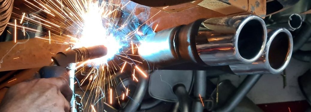 performance exhaust being welded on to the vehicle