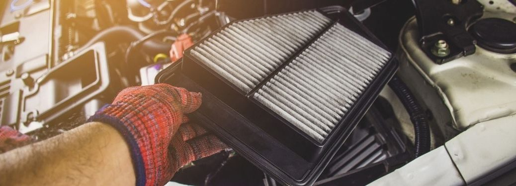 car filter in the hand of a mechanic