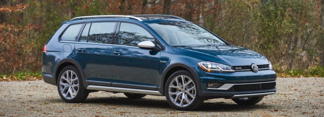Blue 2018 Volkswagen Golf Alltrack Parked next to a Forest