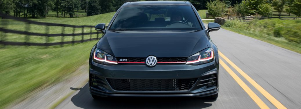 Front View of Black 2018 VW Golf GTI Driving on a Country Road