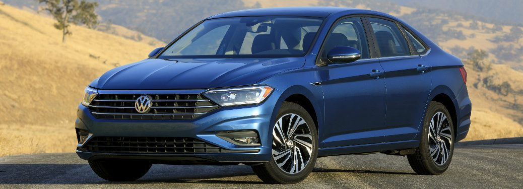 Blue 2019 VW Jetta with Hilly Landscape in the Background