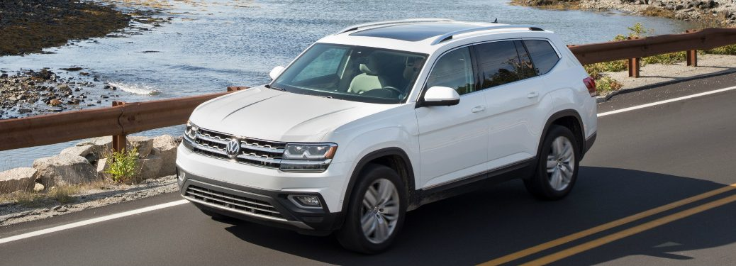 White 2018 VW Atlas Driving by a Lake