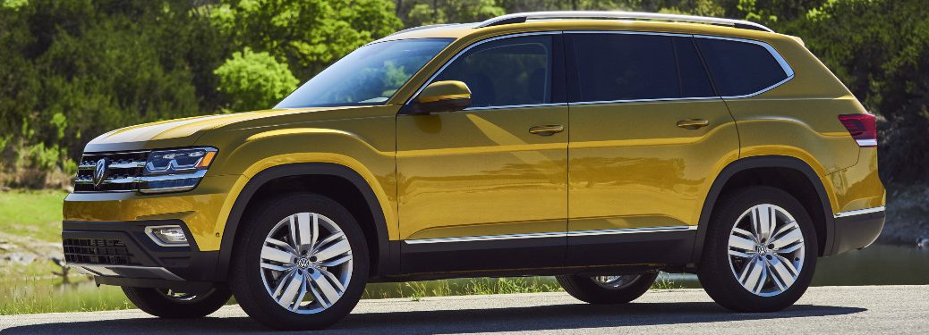 Yellow 2018 Volkswagen Atlas Parked next to a Forest