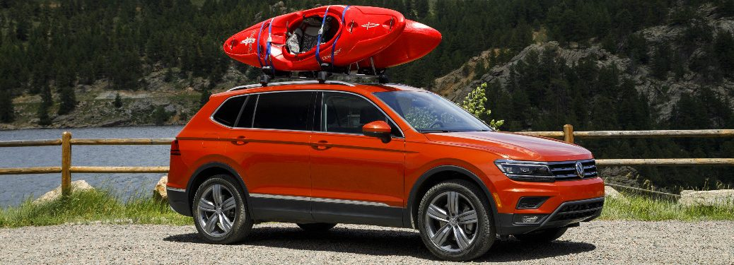 Red Kayaks on the Roof of an Orange 2018 VW Tiguan
