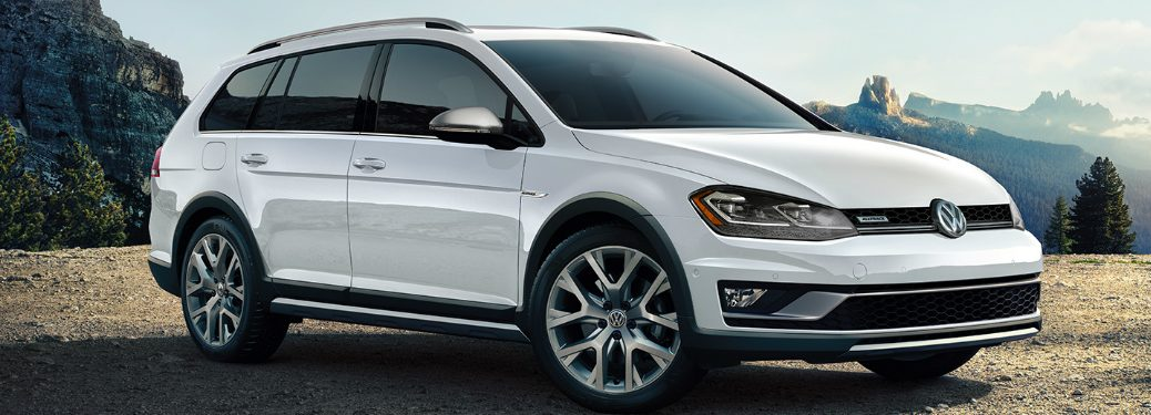 White 2019 Volkswagen Golf Alltrack with mountains in the background