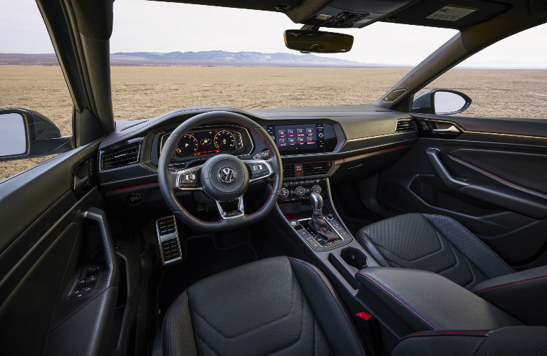 Dashboard and black front seats in 2019 Volkswagen Jetta GLI