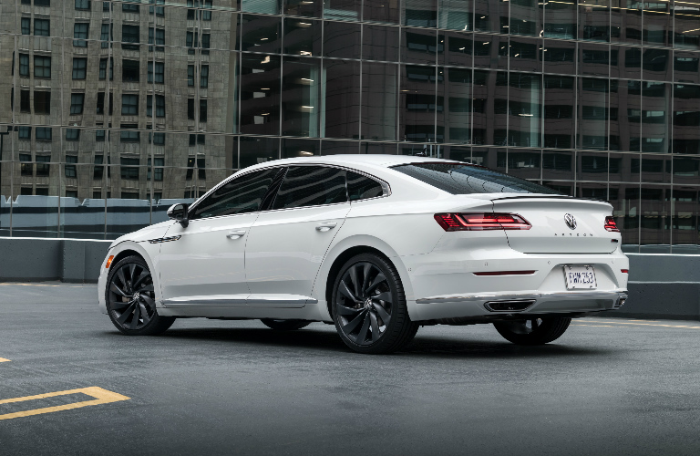 White 2019 Volkswagen Arteon with a skyscraper in the background