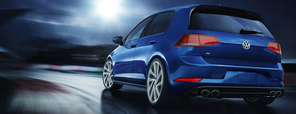 Blue 2019 Volkswagen Golf R driving on a racetrack