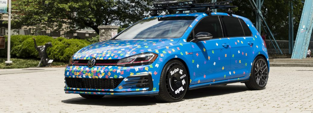 Blue 2019 Volkswagen Golf GTI Rabbit Confetti Concept parked in front of a bridge