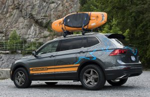 volkswagen tiguan parked with kayak on top