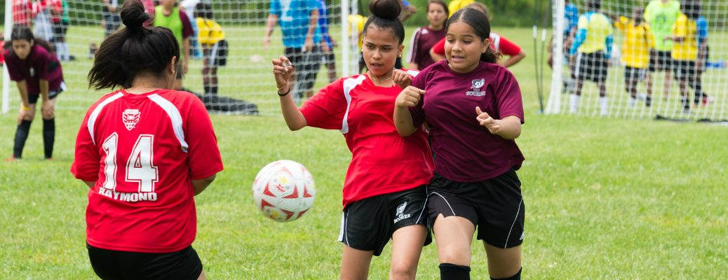 Girls playing soccer for America SCORES program