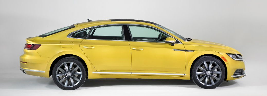 right side view of yellow volkswagen arteon