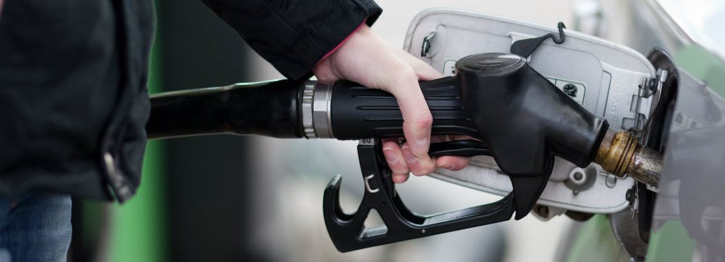 person holding black gasoline nozzle
