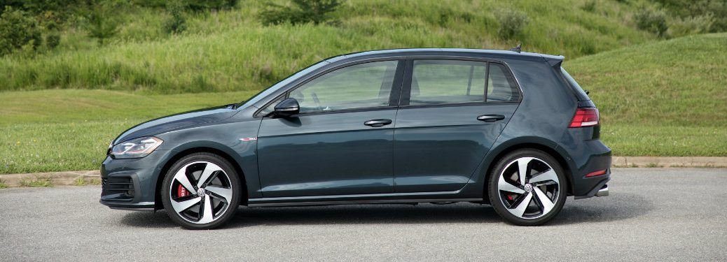 left side view of dark gray volkswagen golf