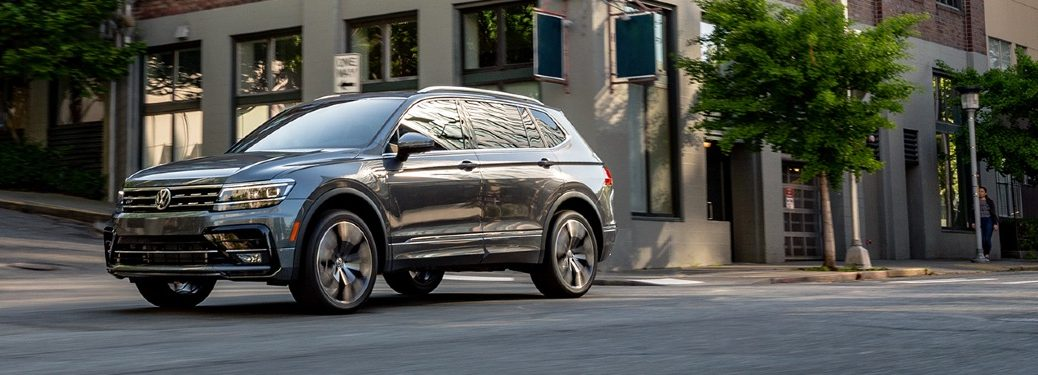 2020 Tiguan driving in an upscale part of city