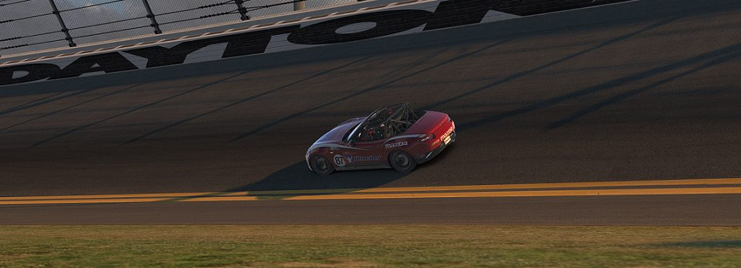 Red Mazda MX-5 Race Car Driving on a Race Track