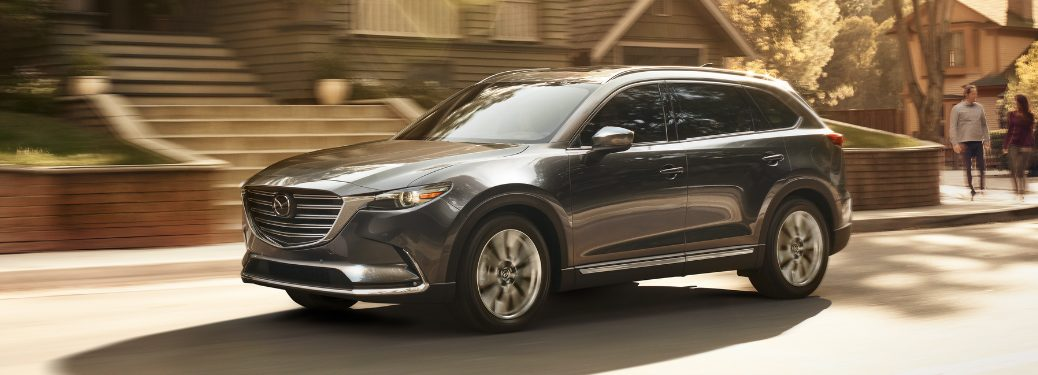 Grey 2018 Mazda CX-9 Driving by a House