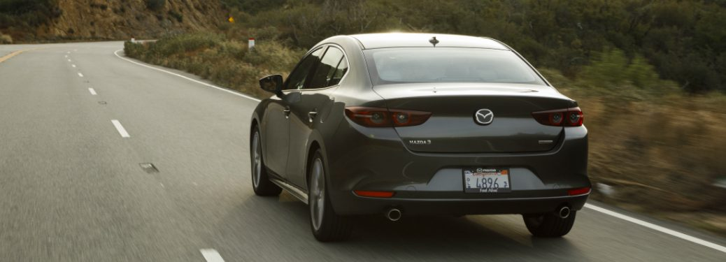 Grey 2019 Mazda3 driving on a mountain highway