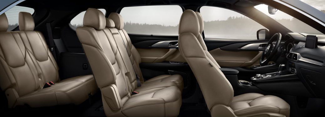 sideview of light colored seats inside mazda cx-9