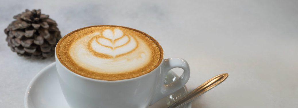 cup of coffee with design in cream