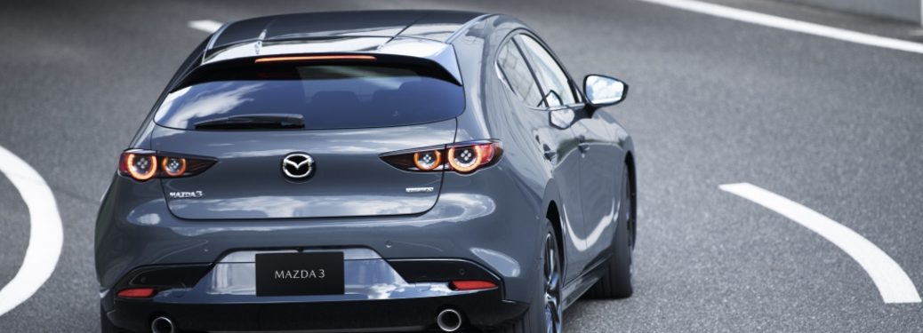 2020 Mazda3 Hatch driving on highway, rear view