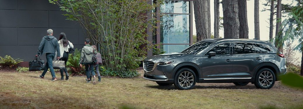 2020 CX-9 parked outside of nice house in the forest