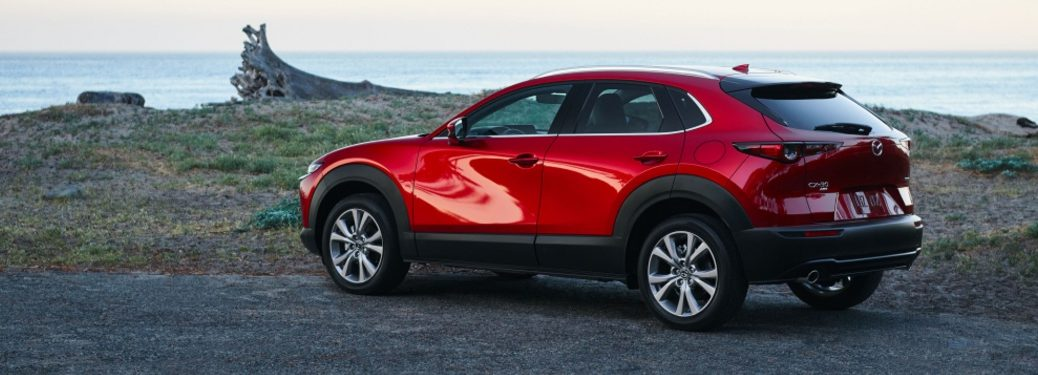 2021 CX-30 exterior rear view parked by waterfront