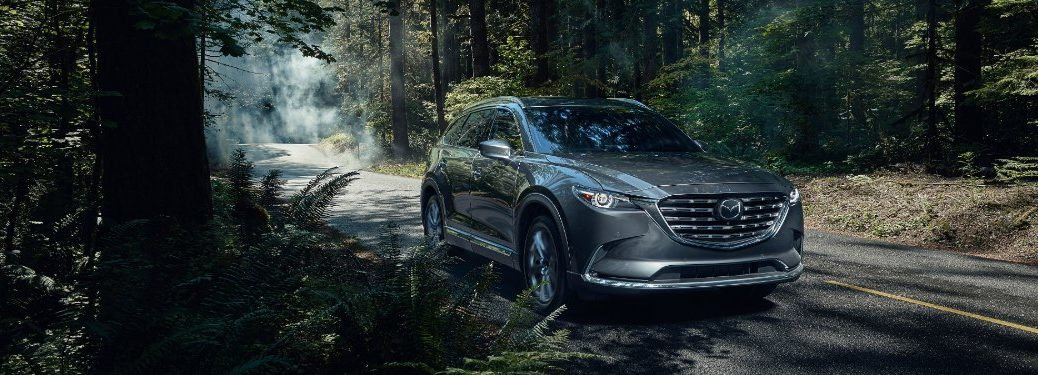 2021 CX-9 parked on a forested road