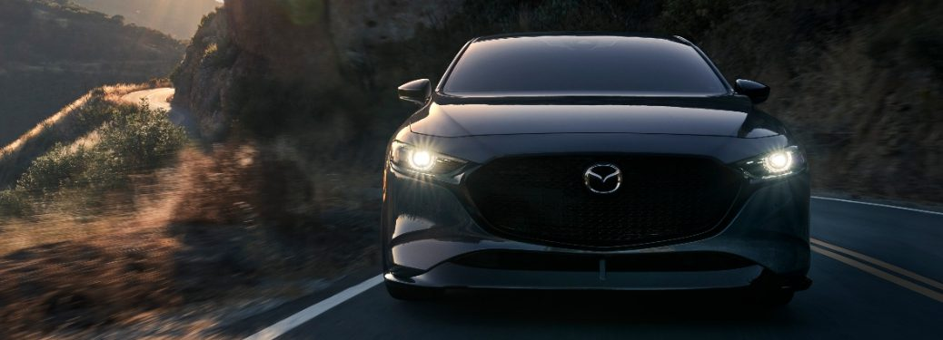 2021 Mazda3 Turbo driving toward camera