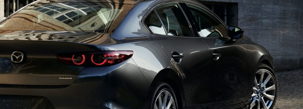 partially obscured 2021 Mazda3 Sedan rear view