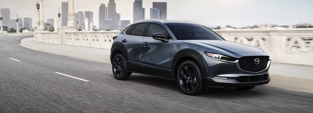 2021 CX-30 Turbo driving away from city