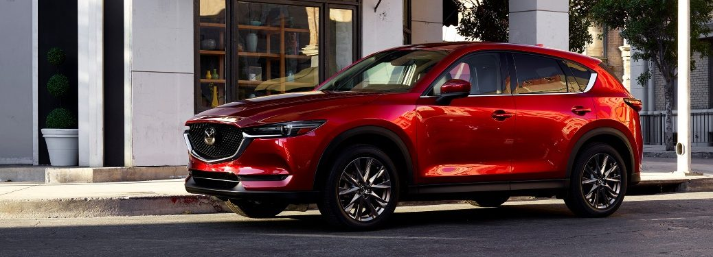 2021 CX-5 parked in front of nice shop