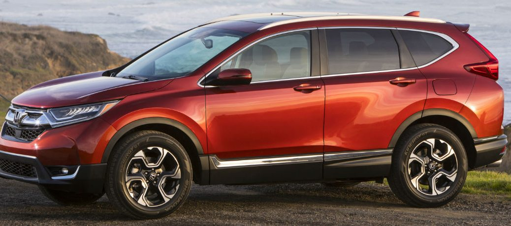 Exterior view of a red 2018 Honda CR-V parked with an ocean in the background
