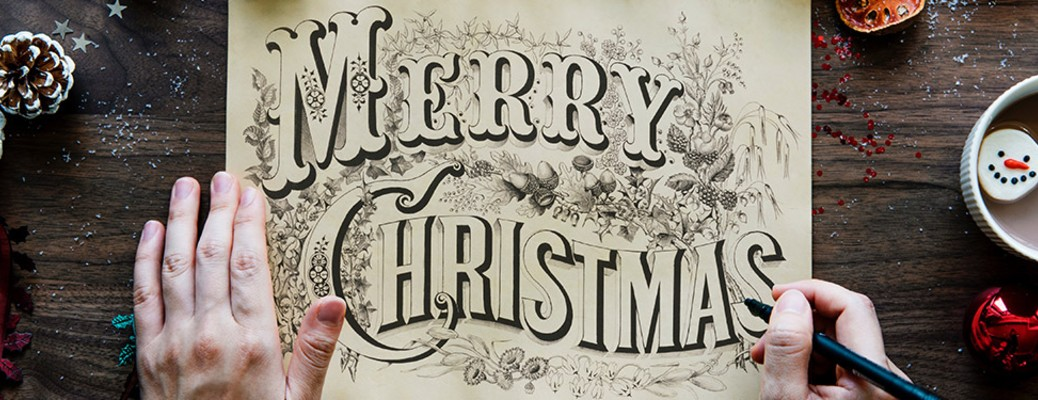 merry christmas text on paper with hands