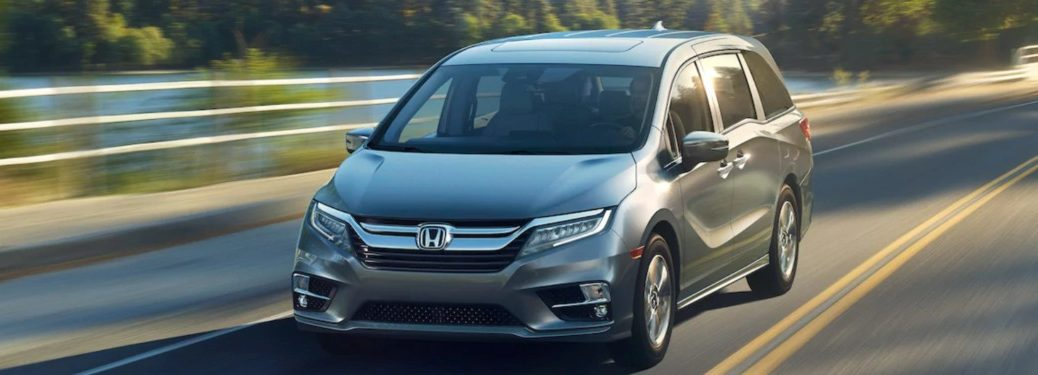 2019 Honda Odyssey driving down a rural road