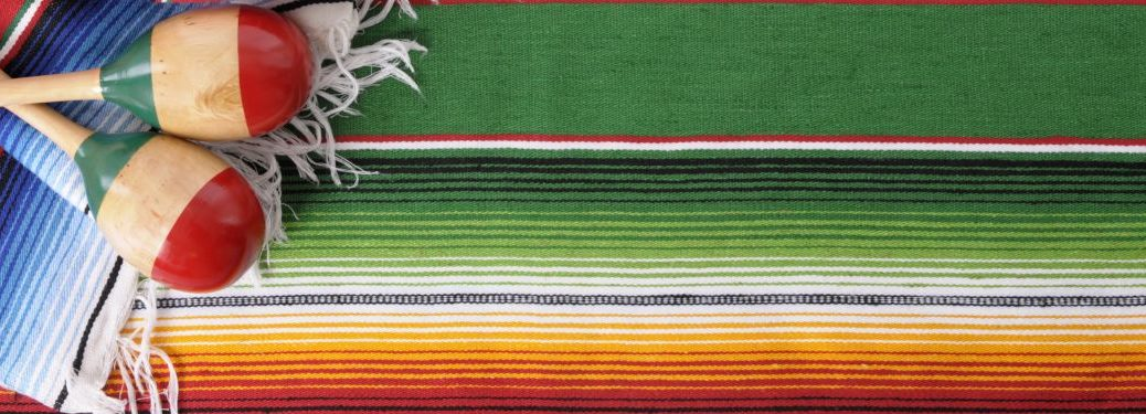 Two maracas and a rug over a colorful background