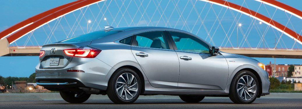 2019 Honda Insight driving on a bridge