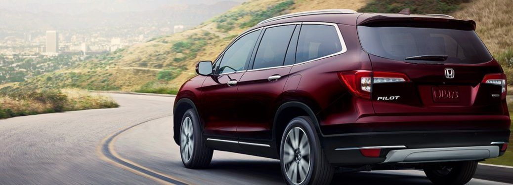 2020 Honda Pilot driving down a curved road