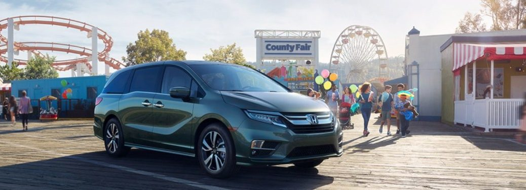 2020 Honda Odyssey parked in front of a festival